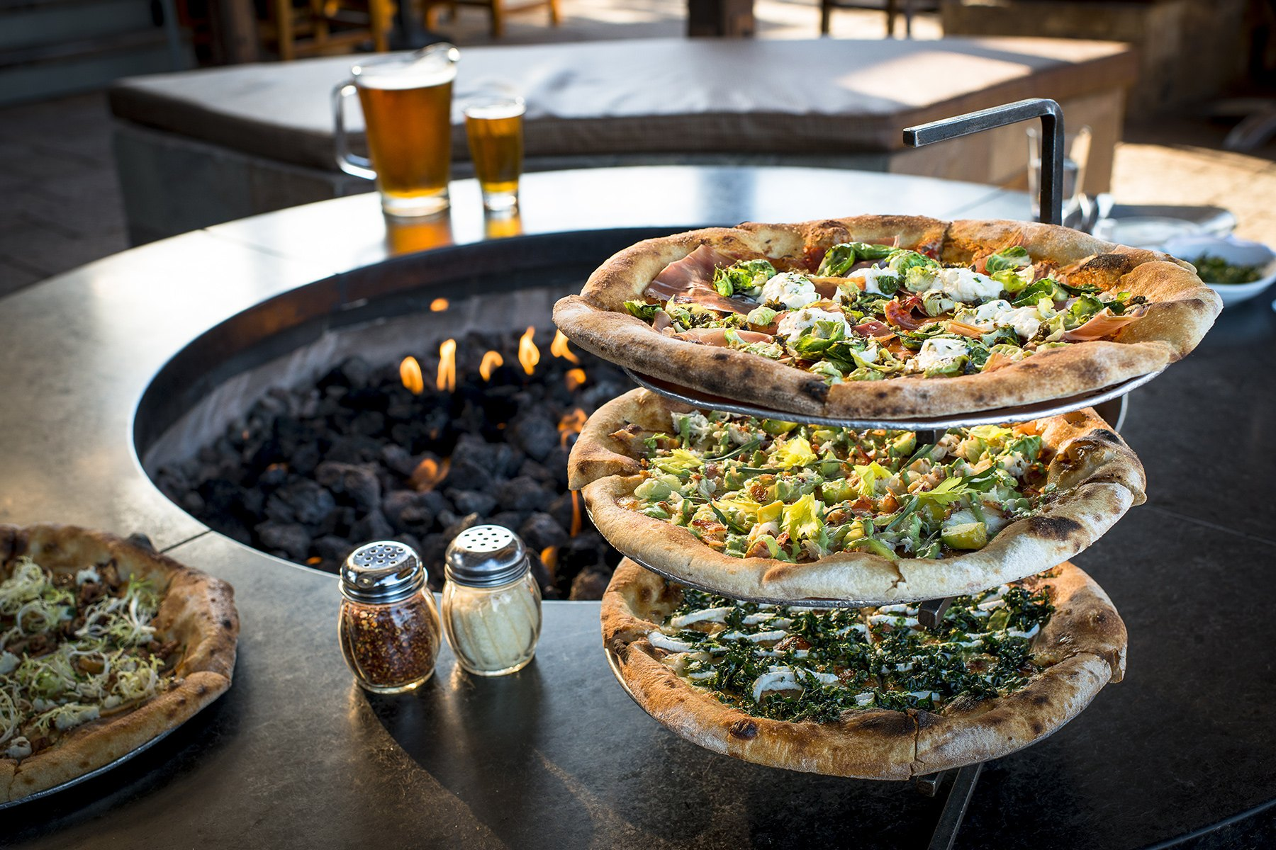 fire pit and stacks of pizza